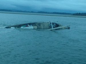 The Pacific Rim, a 60-foot commercial fishing vessel homeported in Westport, Wash., lies partially submerged near the Westport Marina in Grays Harbor, Oct. 23, 2016. The Coast Guard rescued the only person aboard and transferred him to emergency medical services. U.S. Coast Guard photo by Petty Officer 2nd Class Robert Beresh.